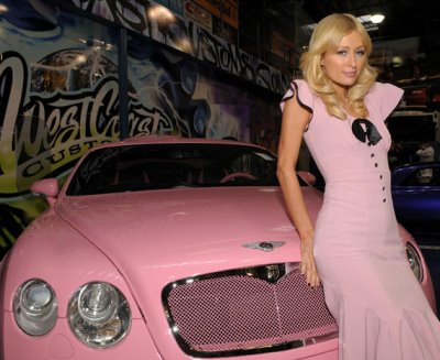 Paris Hilton models on her new pink Bentley