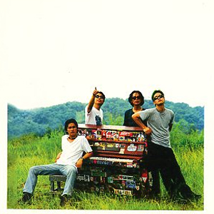 The Eraserheads pose with the piano during their 1997 Sticker Happy album