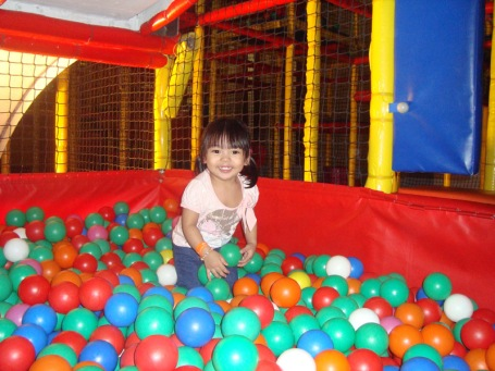 Zoe plays balls at Active Fun